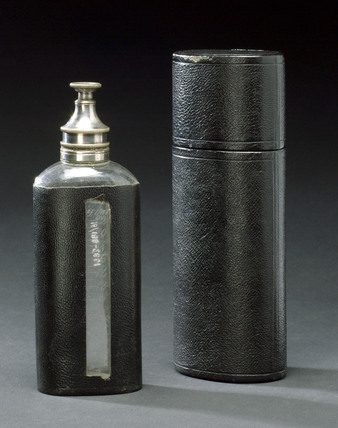 Thomas's chloroform drop bottle in leather case, 1885-1925.