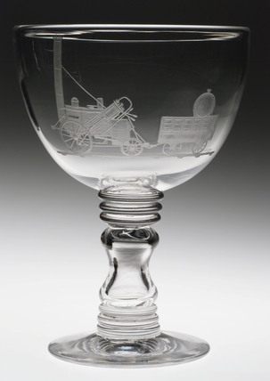Glass goblet engraved with Robert Stephenson's 'Rocket' locomotive, c 1830.