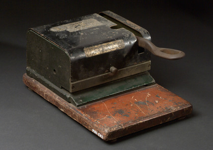 Paper/card stapler, c 1920.