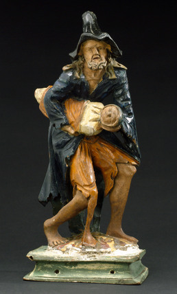Wooden figure of Saint Roman bearing off a child, European, 1801-1900.