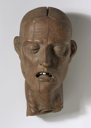 Carved wooden head of a Christian martyr, French, 1501-1600.