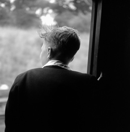 Young boy in coach looking out of window, 1950.