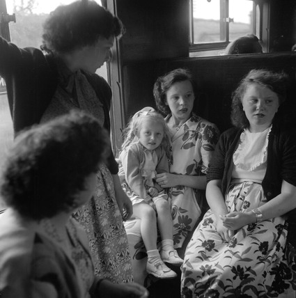 Children travelling in a carriage en route to St Pancras, 1950.