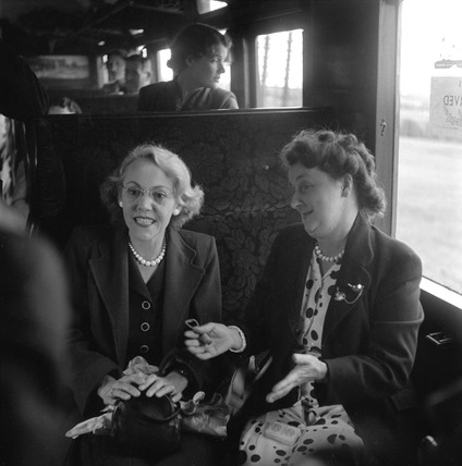 Women sitting in a carriage talking during their journey, 1950.
