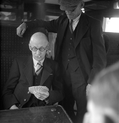 Men playing cards on the train, 1950.