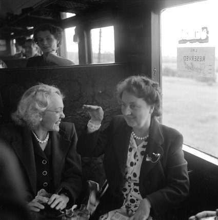 Women talking during a train journey, 1950.
