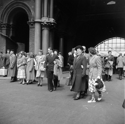 Newly arrived passengers walking from St Pancras station, London, 1950.