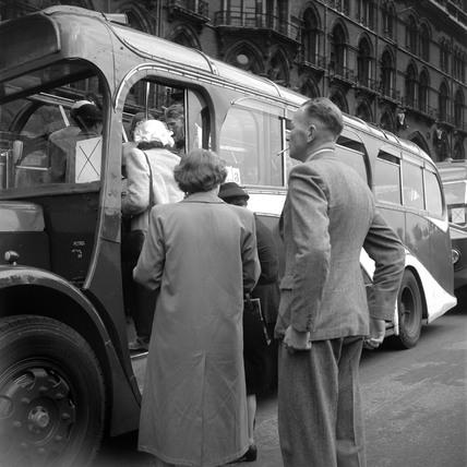 Boarding a tour coach outside St Pancras station, London, 1950.