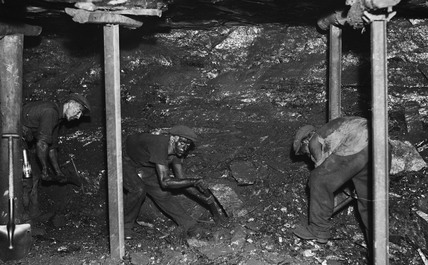 Miners digging for coal, South Wales, 24 June 1931.