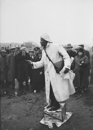 Prince Monolulu performing on a soap box at Epsom Races, 20 April 1931.