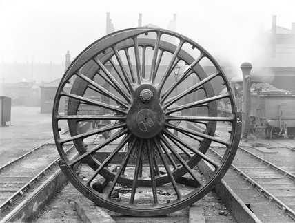 Wheels from a steam locomotive, c 1926.