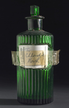 Green glass bottle containing chloroform and morphine, 1900-1979.