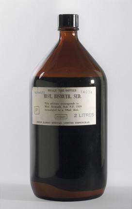 Two litre bottle of Mist Bismuth Sed N F, 1939-1970.