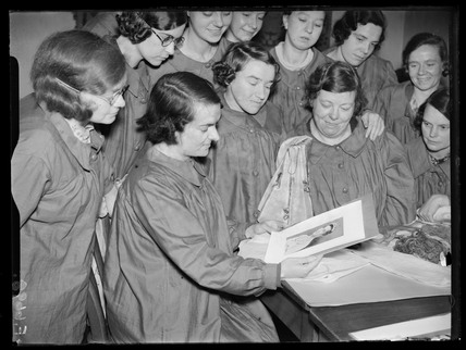 Girls admiring photograph of the Duchess of Kent, 30th December 1937.