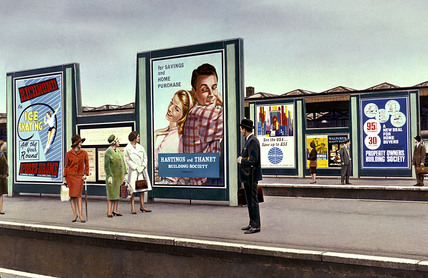 Advertisement hoardings at a London station, c 1962.