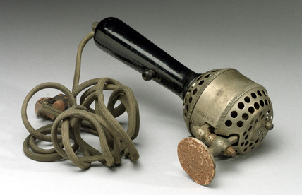 Hand held electric vibrator, 1909.