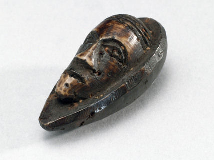 Amulet in the shape of a head, Zaire, before 1992.