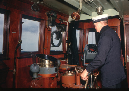 In the ship's wheelhouse, July 1962.