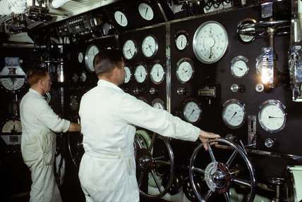 At work in the wheelhouse of the 'Duke of Lancaster', 1965.