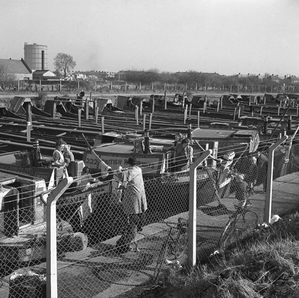 Canal barges at Bulls Bridge lay by, Southall, London, 1950.