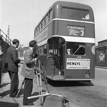 Filming a bus, Bristol, 1950.