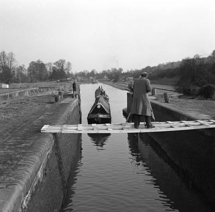 Cameraman filming boats, Slaughter's Lock, Boxmoor, Hertfordshire, 1950.