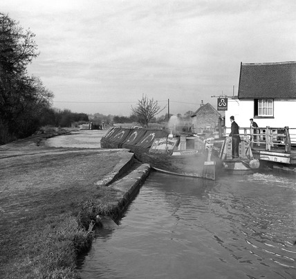 Beresford Brothers' boats passing Winkwell swing bridge, Boxmoor, 1950.