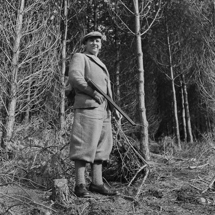 Gamekeeper carrying his gun in a forest near Loch Tay, Scotland, 1951.