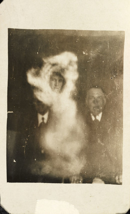 Two men with female 'spirit', c 1920.