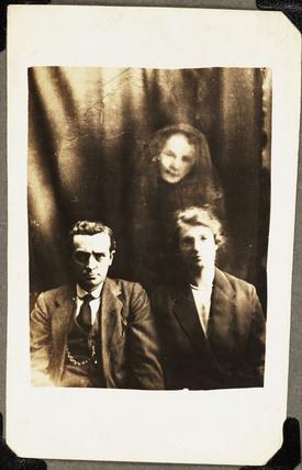 Couple with female 'spirit', c 1920.
