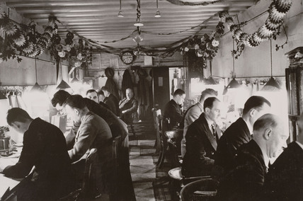 Railway workers in a control room on the Southern Railway, Christmas 1940.