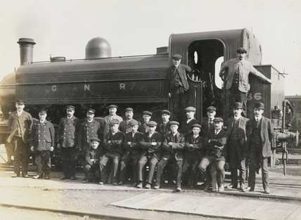 Doncaster works staff beside a tank engine, South Yorkshire, c 1916.