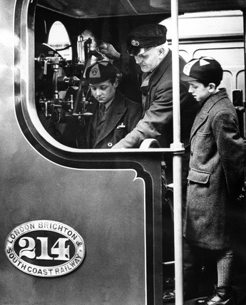 Boys in a locomotive cab, c 1918.