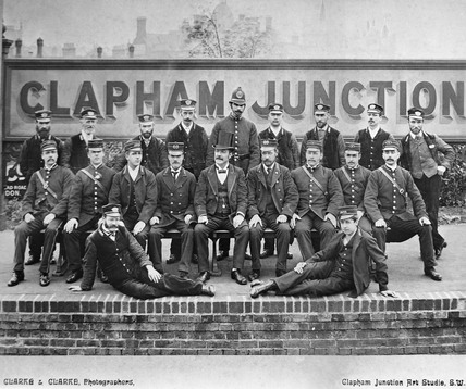 Workers at Clapham Junction Station, London, c 1900.