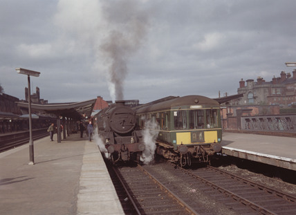 Steam locomotive and diesel locomotive, 1967.