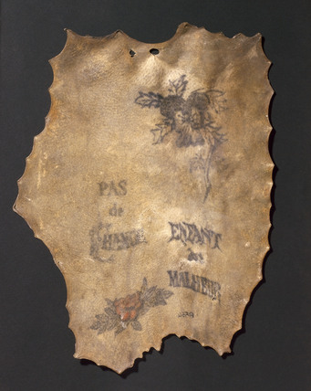 Human skin, tattooed with flowers and inscriptions, French, 1850-1900.