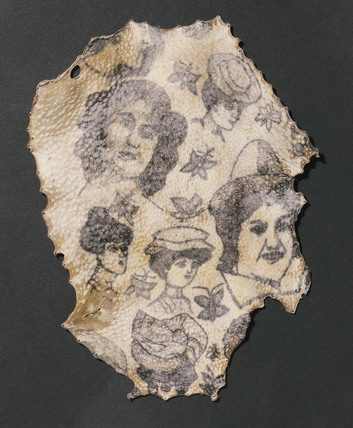 Human skin tattooed of women's heads and butterflies, French, 1900-1920.
