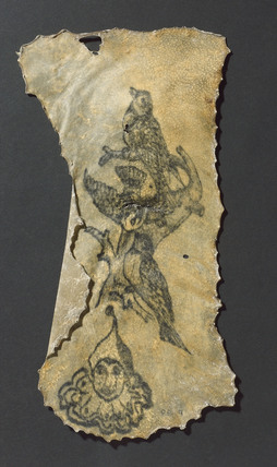 Human skin, tattooed with three birds and clown's head, French, 1850-1920.