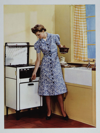 Woman in a kitchen, c 1935.