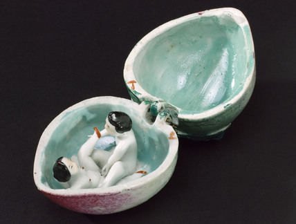 Porcelain fruit containing a man and woman having sex.