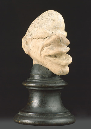 Grotesque head, probably Greek, 3rd to 1st centuries BC.