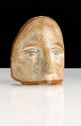 Votive terracotta face, probably Roman, 200 BC-200 AD.