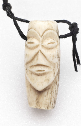 Amulet in the form of a face, Zaire.