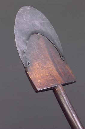 Metal-reinforced wooden spade, 19th century.