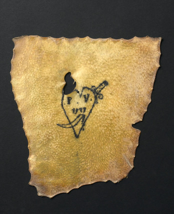 Human skin tattooed with pierced heart and inscription, French, 19th century.