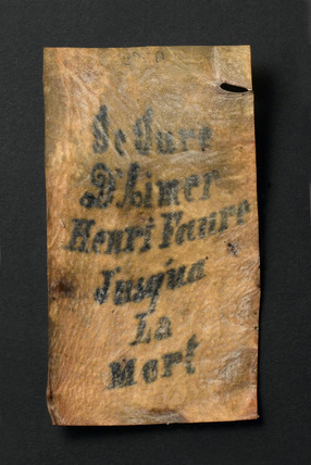 Tattooed human skin with inscription, French,  1850-1920.