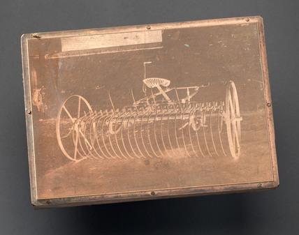 Printing plate showing Huxtable's expandable rake, c 1877-1950.