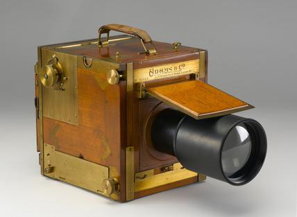 Adams 'Minex' single lens reflex camera, c 1910.