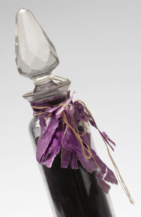 Bottle containing containing mauveine salts, c 1863-1864.