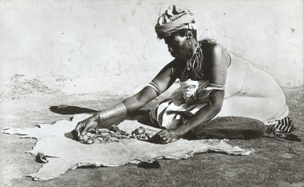 Medicine-woman from Tembuland, South Africa, 1900-1925.